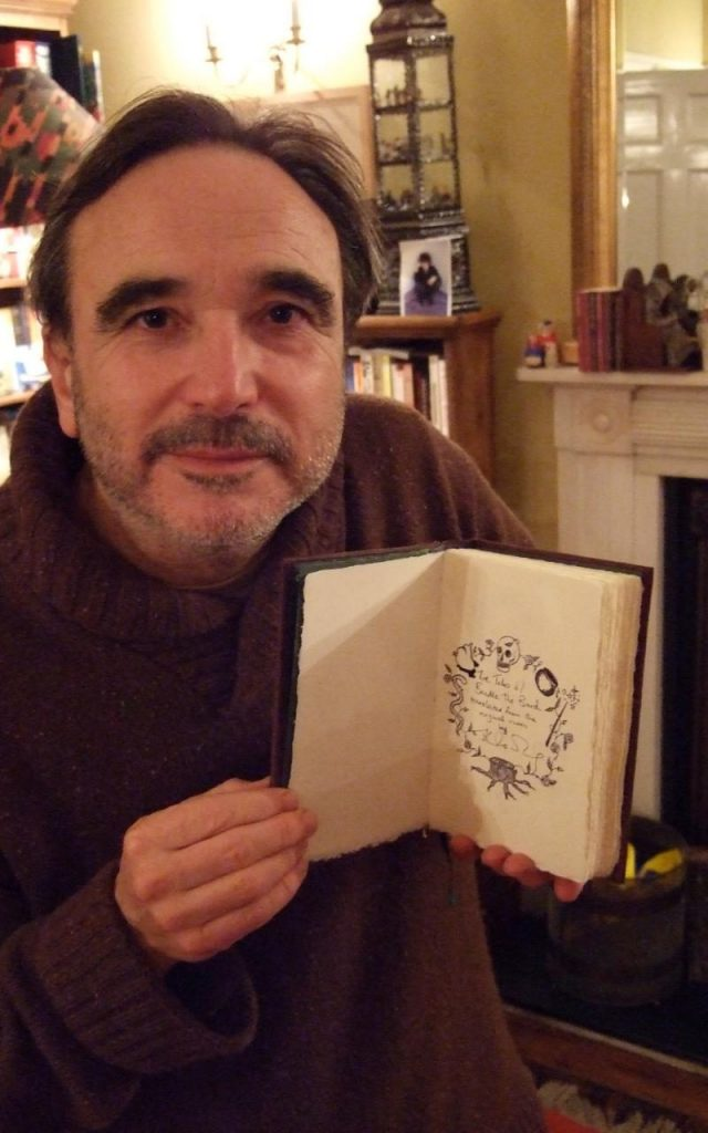 Barry Cunningham with his copy of The Tales of Beedle the Bard.